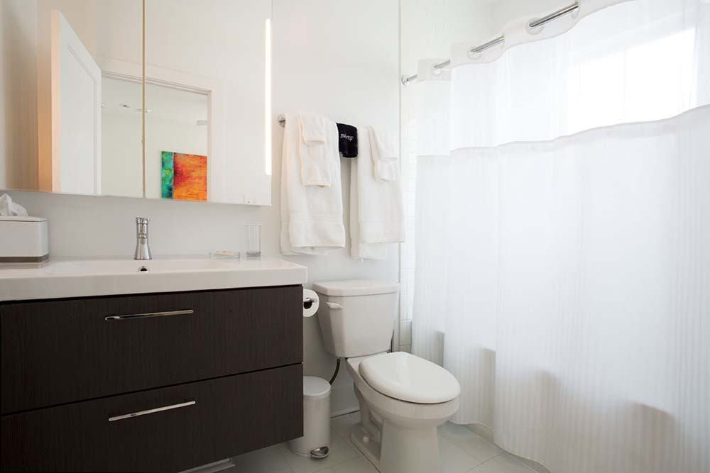 bathroom with modern vanity and shower
