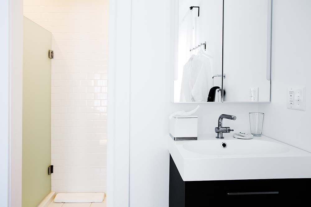 bathroom with modern sink and tile shower