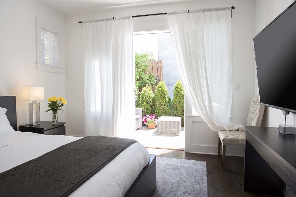Bedroom with door leading to patio