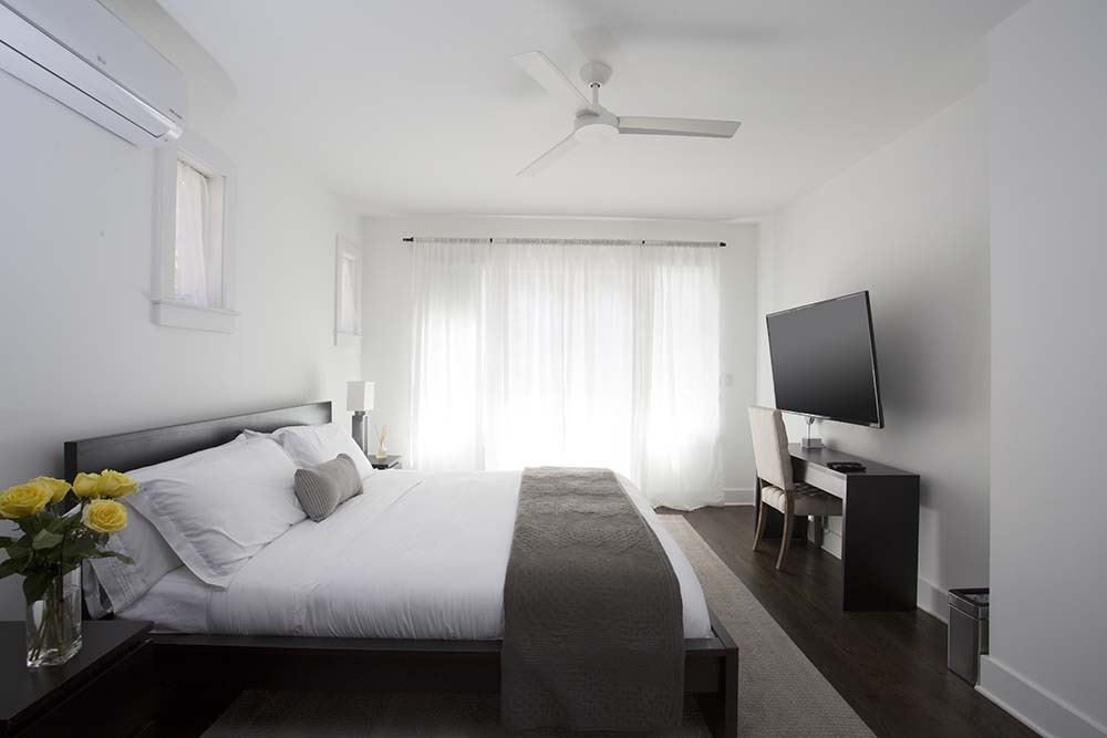 bedroom with king bed, desk and TV
