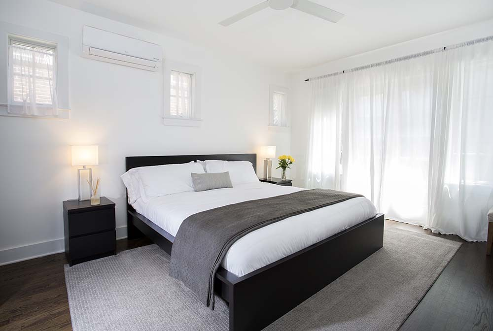 king bed with modern white and black accessories