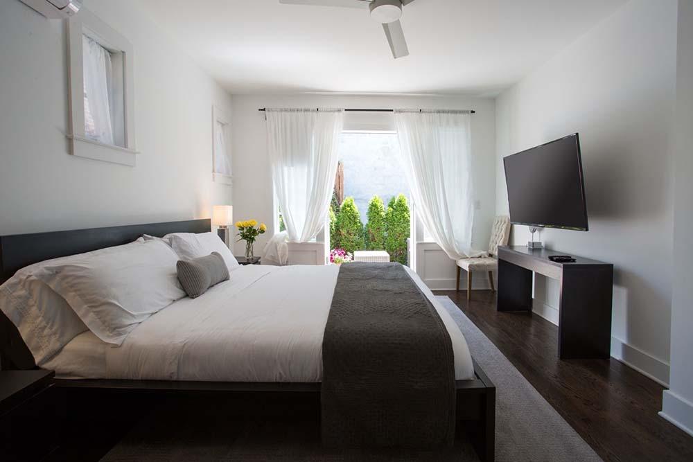 king bed in room with door to patio