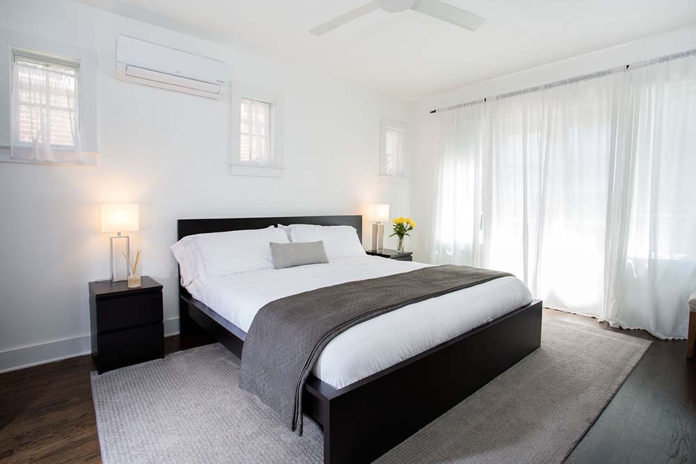large king bed in white painted room