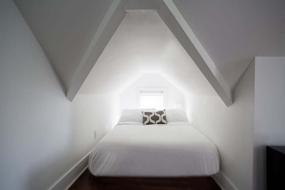Bed tucked into dormer